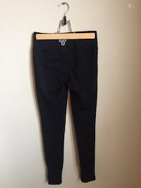 Black TNA leggings with white zipper size Extra small