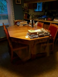 rectangular brown wooden table with four chairs di Stanbridge East, J0J 2H0