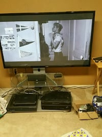 black flat screen TV with black wooden TV stand Sherman Oaks, 91423