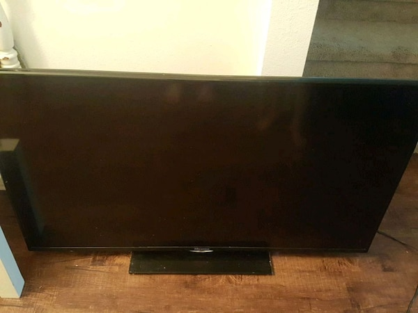 black flat screen TV with remote 50 inch