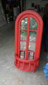red wooden framed glass display cabinet