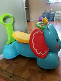 baby's multicolored Fisher-Price snug-and-ride elephant Scott, 70583
