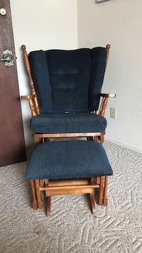 brown wooden blue padded glider chair