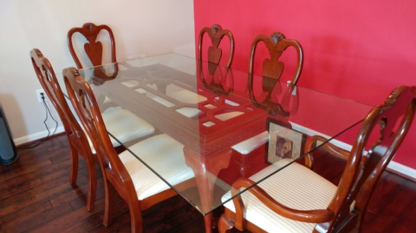 Glass table top with solid cherry wood base