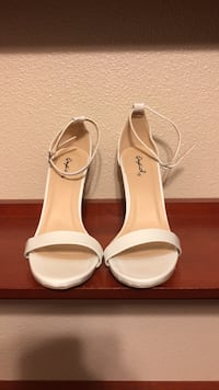 Pair of white leather open-toe ankle-strap heeled sandals