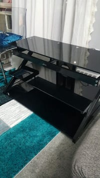 almost new black glass tv stand .  Toronto
