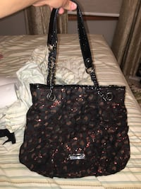 Black and brown leather betsy johnson purse Chatham, 62629