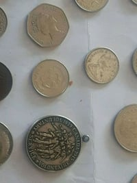 Old coins  .dolphin clock. purse .