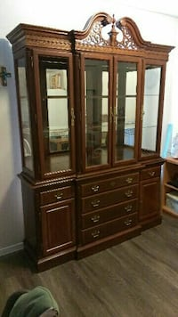 brown wooden cabinet with glass doors Austin, 78729