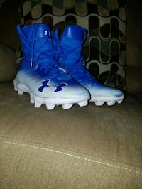 pair of blue-and-white Under Armour cleats Woodstock, 22664