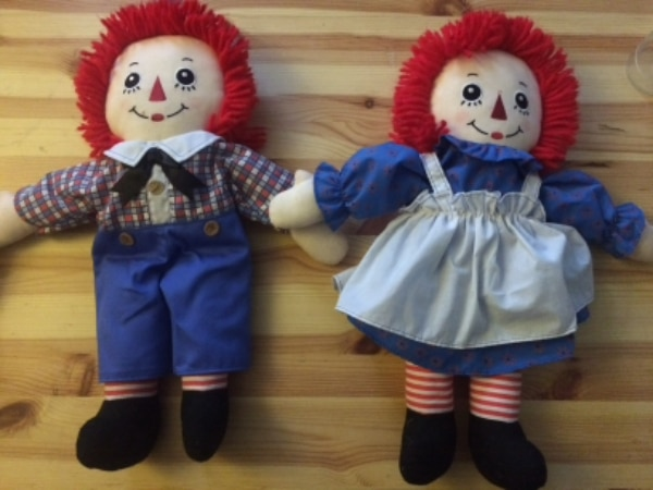 two Raggedy Ann plush toys