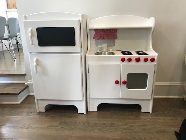 Land of Nod Kitchen set, both stove and refrigerator included, small ship  near burner