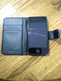 black iPhone 5 with black leather flip case Colorado Springs, 80905