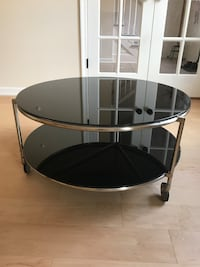 Round 2 tiers black glass table on wheels Hampton, 23666