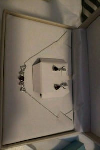 Silver neaclece and earrings .