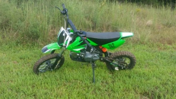 green and black motocross dirt bike