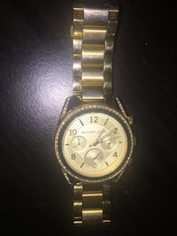 Round gold michael kors chronograph watch with gold link bracelet