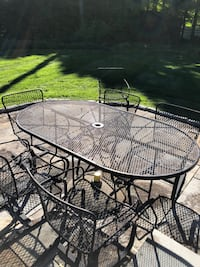 Wrought iron patio table with 6 rocking chairs HARTFORD