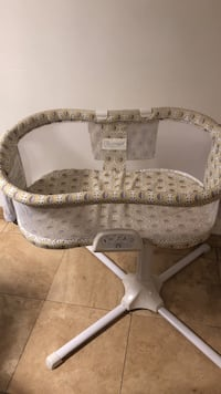 white and brown wooden framed padded armchair