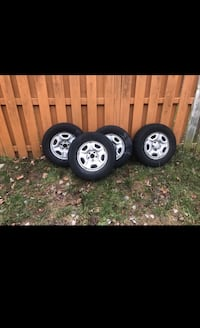 four gray 5-spoke car wheels with tires Herndon, 20170
