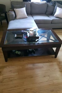 Dark brown wood coffee table with a glass top 91311, 91311