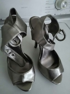 pair of grey leather open toe heels