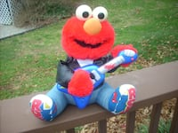 Vintage toy: Rock and Roll Elmo LOUISVILLE