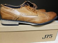pair of brown leather wingtip dress shoes on box
