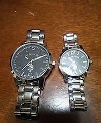two round silver chronograph watches with link bra