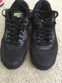 Pair of black-and-gray nike running shoes North Port, 34286