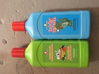 two blue and green labeled bottles