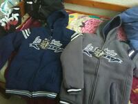 two blue and gray zip-up hoodies