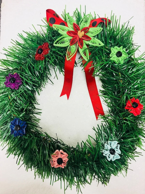 green Christmas wreath with floral accent