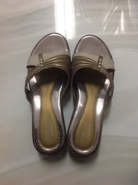 Women's pair of silver-colored-and-brown sandals. Brand new   Surrey, V3T 3G4