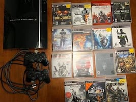 PlayStation 3 with 2 controllers and 15 games