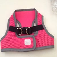 Dog a harness pink... Size XS Velcro closure and also a clip closure with dual rings to attach leash