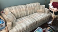 brown and white striped fabric 2-seat sofa