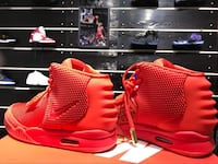 pair of red Nike basketball shoes Calgary, T3E 3L5