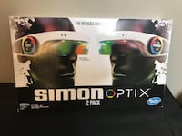 Simon Optix Game 2 Pack BNIB  The Simon game as a wearable headset Connect and play with friends or play solo Watch the lights, remember the colors, repeat the pattern Includes 2 Simon Optix adjustable headsets and instructions x8 1.5V AAA Alkaline batter 544 km