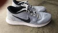 Pair of gray-and-black nike running shoes Corpus Christi