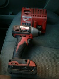 Milwaukee 18 volt impact one battery and charger works great! London
