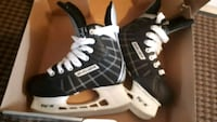pair of black-and-white Bauer ice skates Cambridge, N3C 0C6