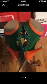 pair of green-and-orange stilettos screenshot