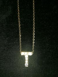 """T"" medallion on 21'inch necklace 2294 mi"