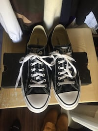 pair of black-and-white Vans sneakers Surrey, V3R 7B8