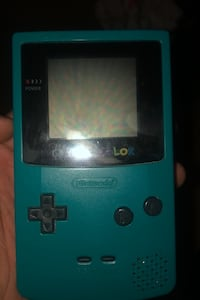 Game Boy Color with Pokémon Gold cartridge