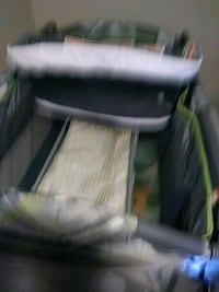 baby's black and green travel cot 46 km