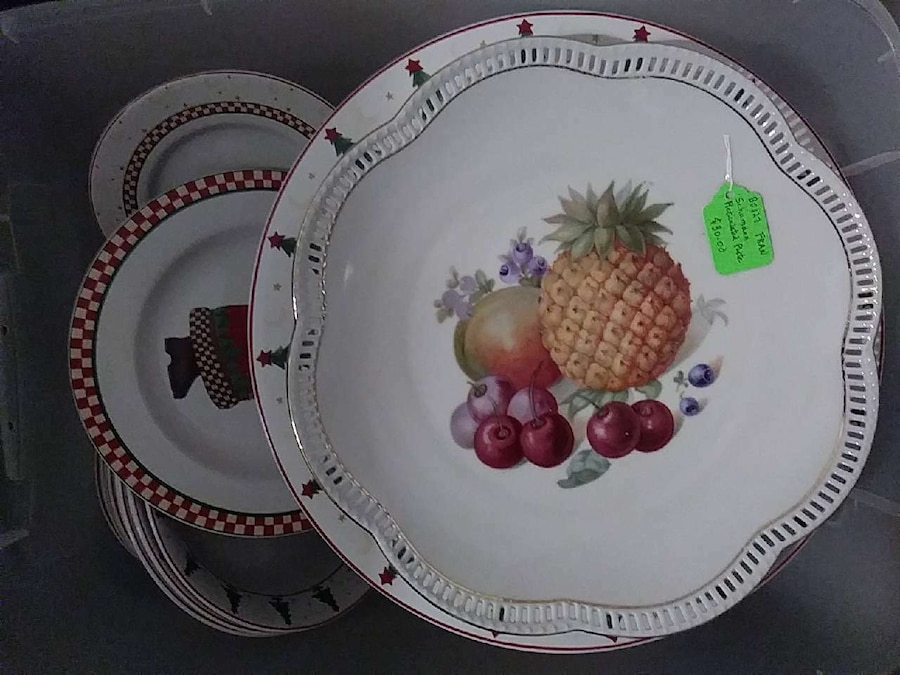 white, brown and red pineapple and berry print palte