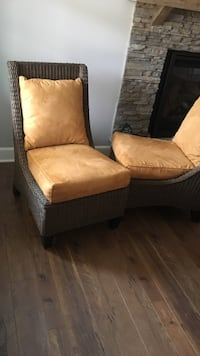 brown wooden framed beige padded armchair 59 mi