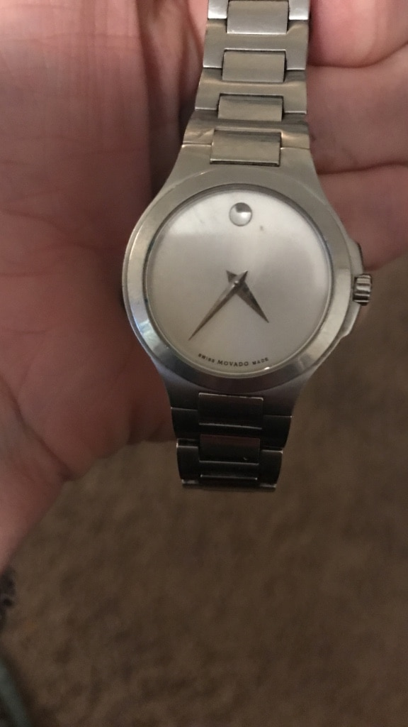 round silver Movado analog watch with silver link bracelet